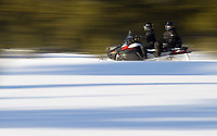 A snowmobile rides through Yellowstone.