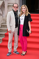 "director, Bjorn Runge and Alix Wilton Regan<br /> arriving for the premiere of ""The Wife"" at Somerset House, London<br /> <br /> ©Ash Knotek  D3418  09/08/2018"