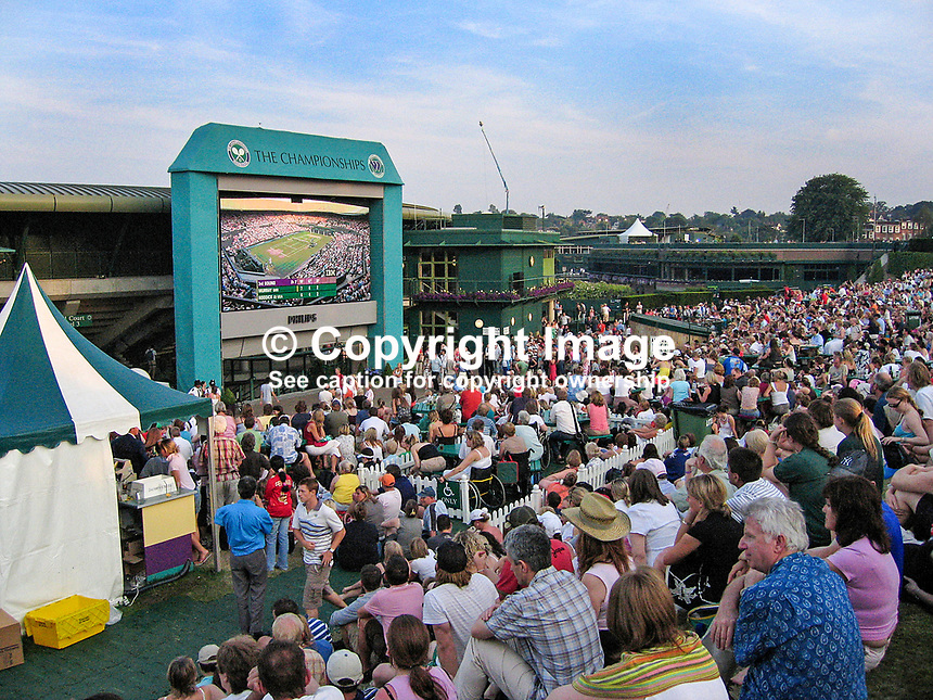 Spectators on Henman Hill, recently renamed Murray Mount, watch Scottish player, Andy Murray, on his way to defeating Andy Roddick, USA, in straight sets on a gigantic television screen in the grounds of the All England Tennis Club, Wimbledon, England. 200607010032..Copyright Image from Victor Patterson, 54 Dorchester Park, Belfast, UK, BT9 6RJ..Tel: +44 28 9066 1296.Mob: +44 7802 353836.Voicemail +44 20 8816 7153.Skype: victorpattersonbelfast.Email: victorpatterson@mac.com.Email: victorpatterson@ireland.com (back-up)..IMPORTANT: If you wish to use this image or any other of my images please go to www.victorpatterson.com and click on the Terms & Conditions. Then contact me by email or phone with the reference number(s) of the image(s) concerned.