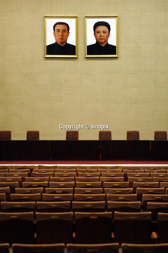 "Portrait of Kim ll-sung and Kim Jong-il inside the People's Palace of Education, Pyongyang, North Korea. The ""Palace"" is the library and place of learning for privileged North Koreans."