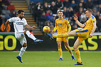 (L-R) Wayne Routledge of Swansea City challenged by Dan Burn of Wigan Athletic during the Sky Bet Championship match between Swansea City and Wigan Athletic at the Liberty Stadium, Swansea, Wales, UK. Saturday 29 December 2018