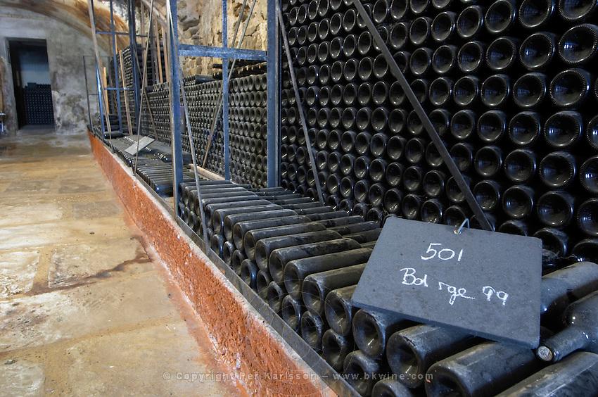 Piles of old bottles aging in the cellar, Bandol rouge red 1999 Chateau Vannieres (Vannières) La Cadiere (Cadière) d'Azur Bandol Var Cote d'Azur France