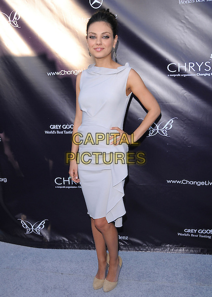 MILA KUNIS .at the 9th Annual Chrysalis Butterfly Ball held at  a private residence in Brentwood, California, USA, .June 5th 2010..full length dress hair up grey gray sleeveless  dress ruffle hand on hip beige shoes .CAP/RKE/DVS.©DVS/RockinExposures/Capital Pictures.