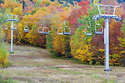 Autumn foliage near a chairlift along the the Mittersill-Cannon Trail on Mittersill ski mountain in the White Mountains of New Hampshire USA
