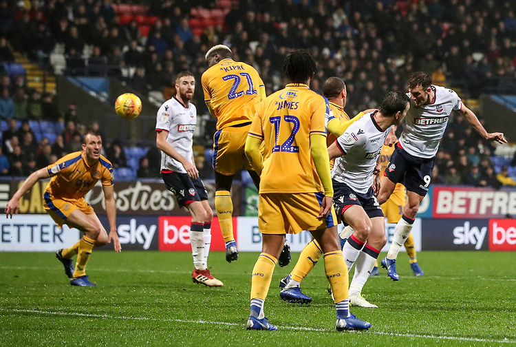 Bolton Wanderers' Christian Doidge heads at goal<br /> <br /> Photographer Andrew Kearns/CameraSport<br /> <br /> The EFL Sky Bet Championship - Bolton Wanderers v Wigan Athletic - Saturday 1st December 2018 - University of Bolton Stadium - Bolton<br /> <br /> World Copyright © 2018 CameraSport. All rights reserved. 43 Linden Ave. Countesthorpe. Leicester. England. LE8 5PG - Tel: +44 (0) 116 277 4147 - admin@camerasport.com - www.camerasport.com