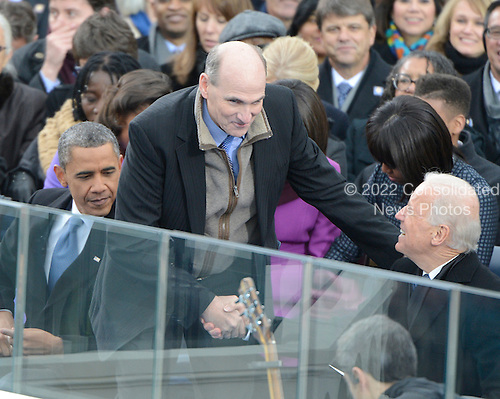 "James Taylor, center, shakes hands with United States Vice President Joe Biden, right, after singing the ""America the Beautiful""  prior to U.S. President Barack Obama, left, taking the oath of office during the public swearing-in ceremony at the U.S. Capitol in Washington, D.C. on Monday, January 21, 2013.  .Credit: Ron Sachs / CNP.(RESTRICTION: NO New York or New Jersey Newspapers or newspapers within a 75 mile radius of New York City)"