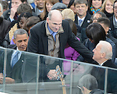 """James Taylor, center, shakes hands with United States Vice President Joe Biden, right, after singing the """"America the Beautiful""""  prior to U.S. President Barack Obama, left, taking the oath of office during the public swearing-in ceremony at the U.S. Capitol in Washington, D.C. on Monday, January 21, 2013.  .Credit: Ron Sachs / CNP.(RESTRICTION: NO New York or New Jersey Newspapers or newspapers within a 75 mile radius of New York City)"""