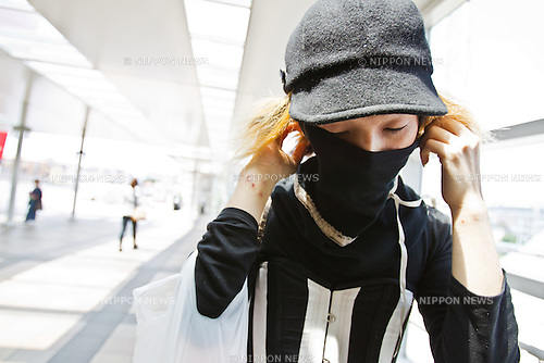"In this photo made available on May 31, 2012 shows Mao Sugiyama putting on a protective mask in Kanagawa, near Tokyo, Japan, on May 29, 2012. Mao Sugiyama, 22, self-described as an asexual now just 2 months old, is a cartoonist, painter and illustrator living in Japan. Mao hated the idea of love and sex due to a series of past events relating to close people around him becoming victims of sexual crimes. In an effort to free himself from mankind, Mao underwent a surgical procedure in Tokyo to remove his male genitals and later serve them to paying guests at a small dinner event. He spent two years conducting extensive research about the removal of his genitals and had several sexual experiences with others prior to the surgery. The reasoning behind Mao's idea to host an event where he would cook his male parts and serve them to guests, was he needed to earn money to help cover the ongoing medical costs of the procedure. Five individuals consisting of men and women out of a small crowd who attended the dinner, ate Mao's specially cooked genitals. The men, however, were not able to completely finish eating the genitals as they grew disgusted whereas the women were able to finish everything on their plates entirely. The women commented on Mao's parts as ""delicious."" With Mao being an artist that he is, his vision is to create beautiful art without the realization of being a man or woman and excluding love and sex out of his system completely. (Photo by Christopher Jue/Nippon News)"