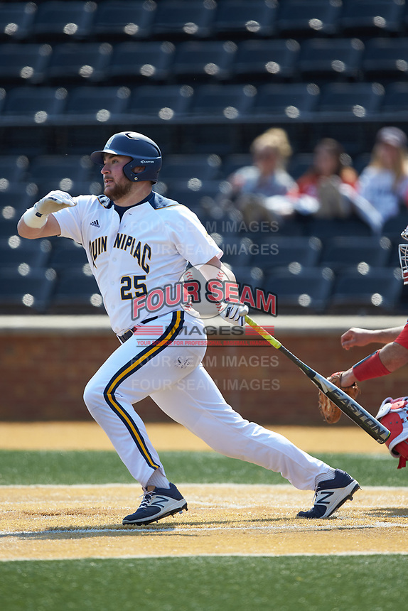 Liam Scafariello (25) of the Quinnipiac Bobcats follows through on his swing against the Radford Highlanders at David F. Couch Ballpark on March 4, 2017 in Winston-Salem, North Carolina. The Highlanders defeated the Bobcats 4-0. (Brian Westerholt/Four Seam Images)