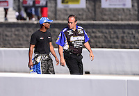 Sept. 14, 2012; Concord, NC, USA: NHRA top fuel dragster driver Antron Brown (left) with crew chief Brian Corrade during qualifying for the O'Reilly Auto Parts Nationals at zMax Dragway. Mandatory Credit: Mark J. Rebilas-