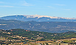 A landscape in the Luberon, including Mont Ventoux, viewed from the top of the village of Lacoste, in Provence, France.