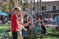 "Alex Palmer '16 and Dan Harris '17 enjoy Spring Fest 2015 Pre-show activities on Stewie Beach. The event included food trucks, a bounce house, a beer garden, live entertainment from the band ""Dinner"", and more. (Photo by Nick Harrington, Occidental College Class of 2017)"