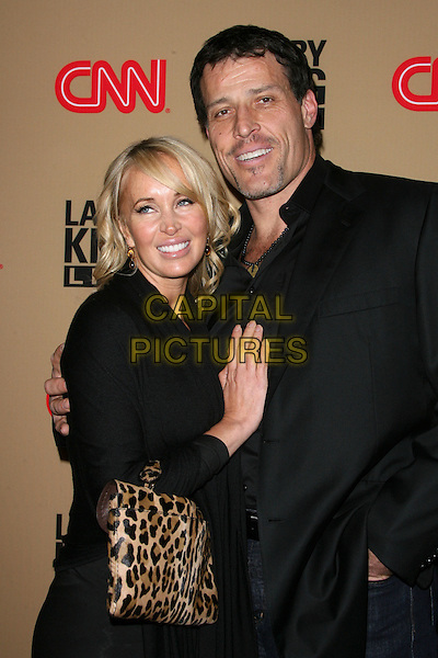 "SAGE ROBBINS & TONY ROBBINS.CNN's ""Larry King Live"" Final Broadcast Wrap Party held at at Spago, Beverly Hills, California, USA..December 16th, 2010.half length black jacket leopard print bag purse married husband wife.CAP/ADM/BP.©Byron Purvis/AdMedia/Capital Pictures."