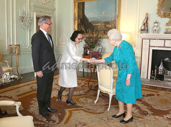 18 October 2016 - Queen Elizabeth II receives the Governor of South Australia, the Hon. Hieu Van Le and his wife Mrs Le at Buckingham Palace in London. Photo Credit: Alpha Press/AdMedia