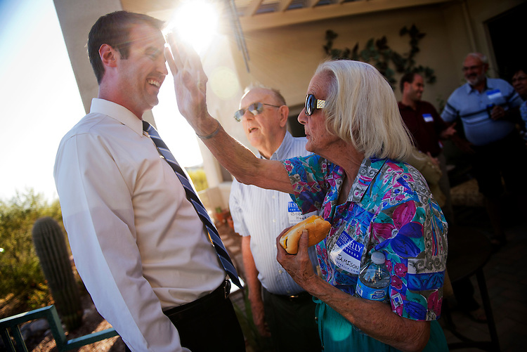 UNITED STATES - MAY 27:  Jesse Kelly, republican contender in the AZ-08 special election, talks with Sue Jamison and Bob Hawks during a fundraiser at the home of Garland and Carolyn Cox, in Tucson, Ariz.  The winner of the election between Kelly and democrat Ron Barber, on June 12th will fill the seat occupied by former Rep. Gabrielle Giffords, D-Ariz.  (Photo By Tom Williams/CQ Roll Call)