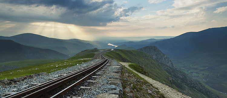 Panorama looking down the mountain railway line on Snowdon towards Clogwyn Station and Llanberis Valley