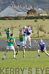 Annascaul Emmet Kennedy during a nice piece of fielding closely watched by team mate Eamon Hickson and John Mitchel's John Higgins and Bryan Costello during the International Championship match at Annascaul GAA grounds on Saturday afternoon.