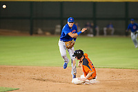 AZL Cubs shortstop Luis Vazquez (1) makes a late throw while jumping over Jacob Gonzalez (52) on a double play attempt against the AZL Giants on September 7, 2017 at Scottsdale Stadium in Scottsdale, Arizona. AZL Cubs defeated the AZL Giants 13-3 to win the Arizona League Championship Series two games to one. (Zachary Lucy/Four Seam Images)