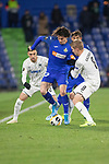 GETAFE, SPAIN - DECEMBER 12: FC Krasnodar's Yuri Gazinskiy and Getafe CF's  Jason in action during the UEFA Europa League group C match between Getafe CF and FK Krasnodar at Coliseum Alfonso Perez on December 12, 2019 in Getafe, Spain. <br /> (ALTERPHOTOS/David Jar)