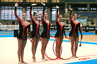 USA Senior Group waves to fans after hoops + clubs routine at 2007 Genoa World Cup of Rhythmic Gymnastics Groups on June 9, 2007 at Genoa, Italy.  (Photo by Tom Theobald)