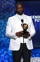 "Jay Rock accepts the award for best rap performance for ""King's Dead"" at the 61st annual Grammy Awards on Sunday, Feb. 10, 2019, in Los Angeles. (Photo by Matt Sayles/Invision/AP)"