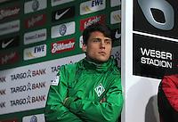 FUSSBALL   1. BUNDESLIGA  SAISON 2011/2012  30. SPIELTAG 10.04.2012 SV Werder Bremen - Borussia Moenchengladbach  Sebastian Boenisch (SV Werder Bremen) verfolgt enttaeuscht nach seiner Roten Karte die 2. Halbzeit aus dem Spielertunnel