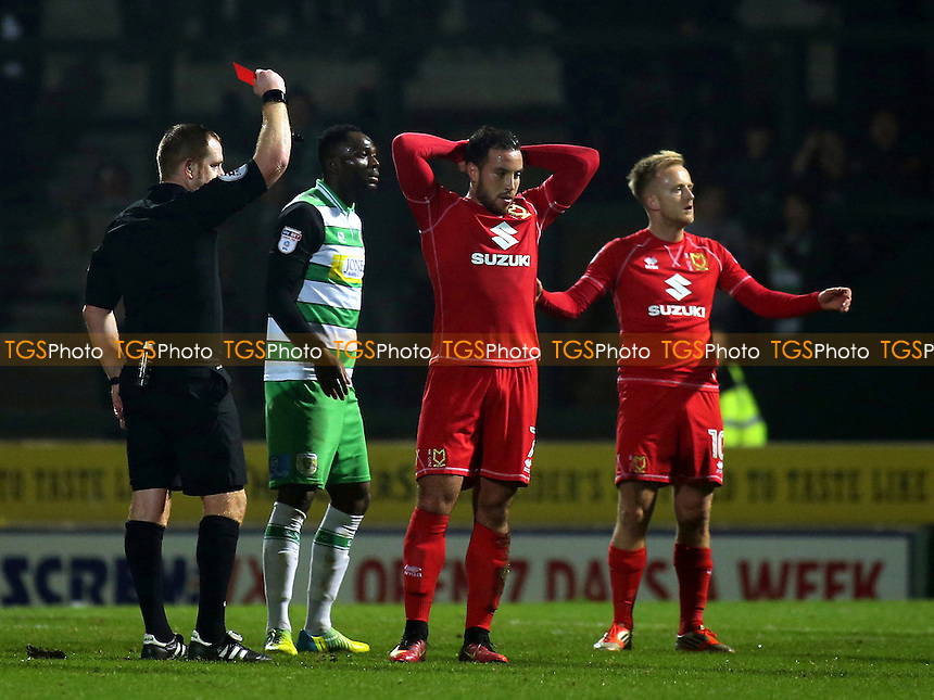 Referee, Lee Swabey, shows a red card to Samir Carruthers of MK Dons during Yeovil Town vs MK Dons, Checkatrade Trophy Football at Huish Park on 6th December 2016