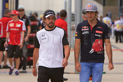 03.07.2015. Silverstone, Northants, England.  Formula 1 British Grand Prix practice. Fellow countrymen Fernando Alonso, McLaren Honda, and Carlos Sainz Jr, Scuderia Toro Rosso.