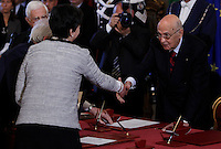 Il Ministro dell'Istruzione e della Ricerca Scientifica Maria Chiara Carrozza stringe la mano al Presidente della Repubblica Giorgio Napolitano, a destra, durante la cerimonia del giuramento del nuovo governo al Quirinale, Roma, 28 aprile 2013..Italian Education and Research Minister Maria Chiara Carrozza shakes hands with Head of State Giorgio Napolitano, right, during the swearing in ceremony of the new government at the Quirinale presidential palace Rome, 28 April 2013..UPDATE IMAGES PRESS/Isabella Bonotto