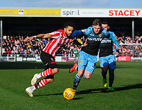 Lincoln City's Bruno Andrade vies for possession with Stevenage's Johnny Hunt<br /> <br /> Photographer Chris Vaughan/CameraSport<br /> <br /> The EFL Sky Bet League Two - Lincoln City v Stevenage - Saturday 16th February 2019 - Sincil Bank - Lincoln<br /> <br /> World Copyright © 2019 CameraSport. All rights reserved. 43 Linden Ave. Countesthorpe. Leicester. England. LE8 5PG - Tel: +44 (0) 116 277 4147 - admin@camerasport.com - www.camerasport.com