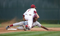 SANTA CLARA, CA - April 19, 2011: Brian Ragira of Stanford baseball looks for the call on a steal attempt during Stanford's game against Santa Clara at Stephen Schott Stadium. Stanford won 10-3.