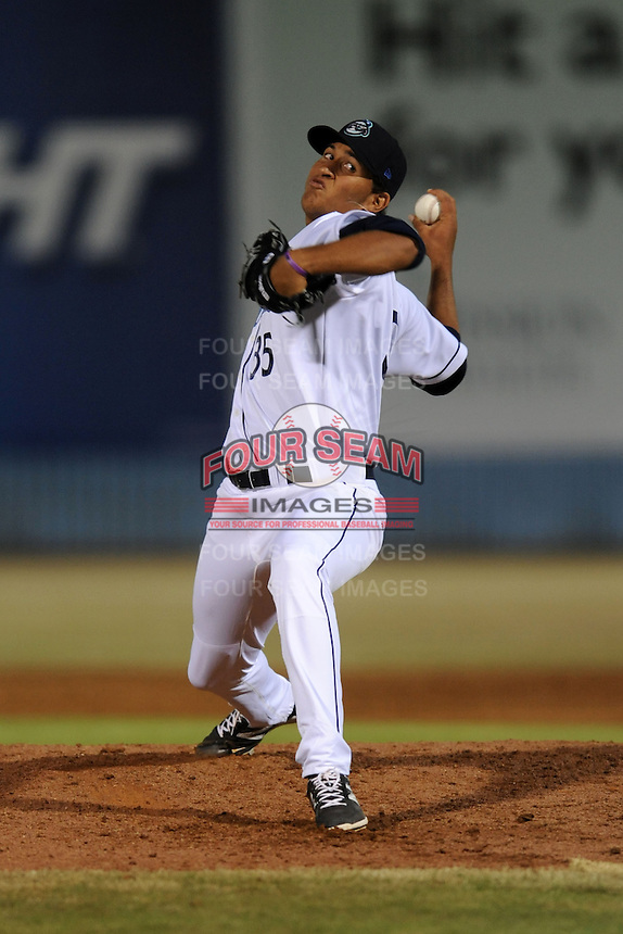 Asheville Tourists pitcher Carlos Estavez #35 delivers a pitch during a game against the Delmarva Shorebirds at McCormick Field on April 4, 2014 in Asheville, North Carolina. The Shorebirds defeated the Tourists 7-2. (Tony Farlow/Four Seam Images)