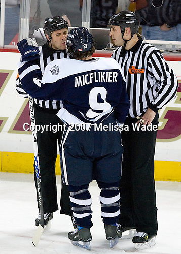 John Gravallese, Jacob Micflikier (UNH - Winnipeg, MB), Bob Bernard - The Boston College Eagles defeated the University of New Hampshire Wildcats 4-2 on BC's senior night, Saturday, March 3, 2007, at Kelley Rink at Silvio O. Conte Forum in Chestnut Hill, Massachusetts.