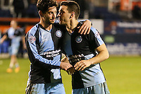 Joe Jacobson of Wycombe Wanderers and Matthew Bloomfield of Wycombe Wanderers after the Sky Bet League 2 match between Luton Town and Wycombe Wanderers at Kenilworth Road, Luton, England on 26 December 2015. Photo by David Horn.