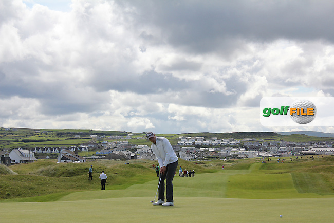 Jeff Hopkins (The Royal Dublin) on the 15th green during Matchplay Round 3 of the South of Ireland Amateur Open Championship at LaHinch Golf Club on Saturday 25th July 2015.<br /> Picture:  Golffile | TJ Caffrey