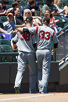Nashville Sounds pitcher Travis Webb (33) walks to the clubhouse with teammate Johnny Hellweg (38) after Hellweg was removed from the game against the Round Rock Express in the Pacific Coast League on May 5, 2013 at the Dell Diamond in Round Rock, Texas. Round Rock defeated Nashville 5-1. (Andrew Woolley/Four Seam Images).