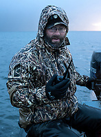 Guide and owner of Four Flyways Outfitters Jeff Wasley drives a boat in Cold Bay, Alaska, Thursday, November 3, 2016. The Izembek National Wildlife Refuge lies on the northwest coastal side of central Aleutians East Borough along the Bering Sea. <br /> <br /> Photo by Matt Nager