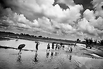 In late August, the Kosi River in India overflowed its banks in the state of Bihar after severe monsoon rains caused a dam to burst in neighboring Nepal, triggering what officials are calling the worst floods in 50 years..September 10, 2008, flood-affected  villagers escape from their submerged villages in ARARIA district..