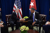 United States President Barack Obama, right, attends a bilateral meeting with President Raul Castro, left, of Cuba at the United Nations Headquarters, New York, New York on September 29, 2015. <br /> Credit: Anthony Behar / Pool via CNP