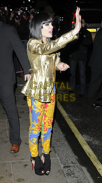 JESSIE J .At the BRIT Awards 2011 Universal after party, The Savoy hotel, London, England, UK, .February 15th 2011..Brits full length gold jacket midriff bra top blue zip gold yellow sun print trousers patterned cropped crop black peep toe ankle boots hand waving .CAP/CAN.©Can Nguyen/Capital Pictures.