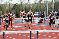 (left to right) Andrew Madison, Quincy Hall, Trenton Stringari, and Austin Corley fly down the homestretch of the boys 300-meter hurdles at the 2015 Kansas Relays.