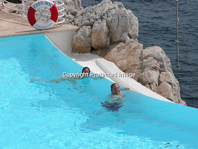 Harvey Weinstein swimming with his girlfriend at the Hotel Du Cap pool - Cannes Film Festival.**EXCLUSIVE** .Tuesday, May 20, 2003.Cap D' Antibes, France.Photo By Celebrityvibe.com/Photovibe.com