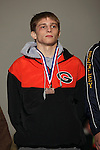 02/26/11--Gladstone's Jimmy Alger placed fifth place with his win over Estacada's Donny Wenlund in the 112 weight division of the 4A wrestling state championship at the Memorial Coliseum..Photo by Jaime Valdez..........................................