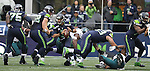 Seattle Seahawks offensive linemen blocks for quarterback Russell Wilson (3) as he scrambles against the Philadelphia Eagles at CenturyLink Field in Seattle, Washington on November 20, 2016.  Seahawks beat the Eagles 26-15.  ©2016. Jim Bryant Photo. All Rights Reserved.