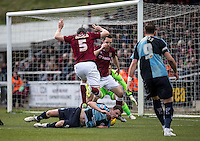 Stephen McGinn of Wycombe Wanderers is brought down in the box during the Sky Bet League 2 match between Northampton Town and Wycombe Wanderers at Sixfields Stadium, Northampton, England on the 20th February 2016. Photo by Liam McAvoy.