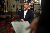 United States President Barack Obama, wearing a bow tie similar to Supreme Court Justice Paul Stevens, tapes a message regarding the justice's retirement in the Map Room of the White House, Friday, May 14, 2010.  .Mandatory Credit: Samantha Appleton - White House via CNP