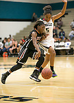 Connally's E'nisha Fowler collides with Hutto's Taylor Scott Friday at Connally Gym.  The Hutto Hippos beat the Connally Cougars 54-42.  (LOURDES M SHOAF for Round Rock Leader.)