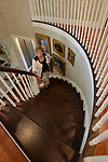 """Homeowner Margaret Lowery on the spiral staircase located at the entryway. """"At Home"""" with Margaret Lowery in her Lake Christine Drive home in Belleville, IL on July 24, 2019. <br /> Photo by Tim Vizer"""