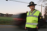 Ernest Rudder is the crossing guard for Bush Middle School. At 7:45 am, he directs traffic and makes sure the children get into school safely. His day is just getting started. After his shift as a crossing guard he heads to the Laurel County Sheriffs office to go over paperwork, and run through his routine for the day. Ernest Rudder is a former school teacher, middle school principal and a current administrative Sgt. with the Laurel County Sheriff's Department. He taught high school biology, and worked in the Bush school district for a total of 31 years. Rudder is not only a Sheriff's Deputy but he's a family man, and not a single person has a bad thing to say about him. Photo by Kirsten Holliday
