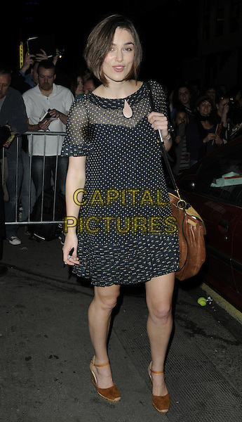 "KEIRA KNIGHTLEY .Seen leaving after the evening performance of ""The Children's Hour"", Comedy Theatre, London, England, UK, April 22nd 2011..full length black sheer collar ruffle print dress brown shoes wedges bag polka dot white .CAP/CAN.©Can Nguyen/Capital Pictures."